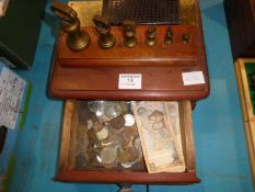 A set of 6 brass Bell Weights 1lb down to 1/2oz and a wooden drawer of mixed coins