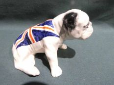 A Carlton Ware pottery model of a British Bulldog with Union Flag - seated
