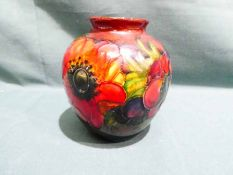 A Moorcroft pottery Vase of squat baluster form with everted neck, tubeline decorated with