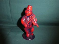 A Royal Doulton Snowman Violinist in rare flambe glaze, Not Produced for Sale, 13.5cm high