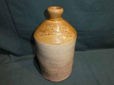 An earthenware Spirit Flagon, impressed R Pearson Wine and Spirit Merchant Cockermouth, 28cm high