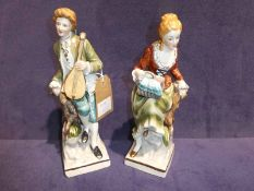 A pair of 20th century Sitzendorf figures as a Gallant and his Beau, each 26cm high