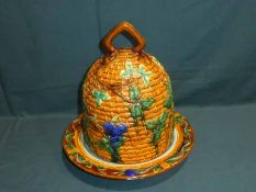A large Majolica style Cheese Bell and Stand in the form of a Bee Skep, 38cm high
