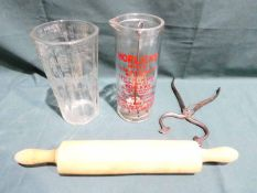 A one pint Horlicks Mixer, a vintage glass Liquid Measure, a wooden Rolling Pin and a pair of