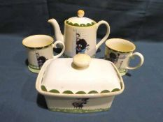Four items of Carlton Ware Gollywogg Company Tableware, Trial Teapot, two Beakers and lidded sample