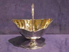A good quality George III late 18th century silver Sugar Basket, shaped oval form, gilt interior