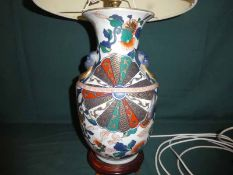 A Chinese style polychrome decorated baluster shape Vase converted to a Table Lamp base, 40cm