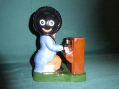 A Carlton Ware hand painted Golly figure, the Piano Player, limited edition 121 of 1250, 19cm high