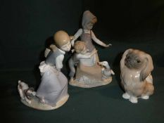 Three Lladro porcelain Figural Models: Boy and Girl with a Goose, 26cm high, Girl with a Dog pulling