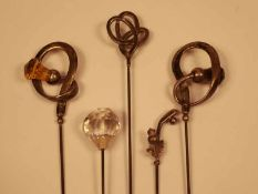 A small collection of silver and white metal monumental steel Hat Pins,