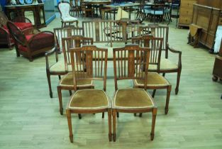 An Edward VII walnut parlour suite of two seat Settee, twin Armchairs and four Dining Chairs, the