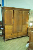 Marsh, Jones, Cribb & Co oak triple Wardrobe with interior mirrored central drawer flanked by