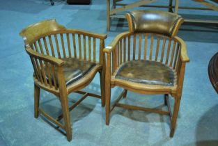 A set of 12 1930s oak boardroom chairs with flared backs on lathe supports over padded seats and