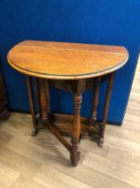 Small oak drop leaf table with pierced end supports and turned swing legs, Liberty of London label