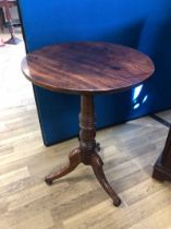 19th Century circular occasional table on turned pedestal to tripartite base. 49cm dia