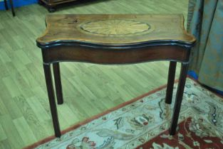 A George III serpentine mahogany fold-over Tea Table with fan paterae and satinwood cross banding on