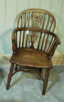 A Yew and Elm Windsor Chair with low back and Crinoline Stretcher