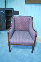 An Edward VII mahogany framed armchair, with satinwood banding and fleur de lys upholstery, on