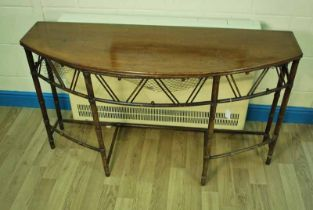 A Regency period 'Brighton Pavilion' mahogany Games Table with hinged top opening to reveal a netted