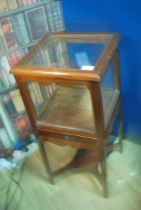 A 19th century mahogany display cabinet with single drawer on chamfered legs with cross stretcher