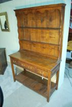 A George III style handmade oak Dresser with two shelf Plate Rack over a three drawer Pot Shelf,