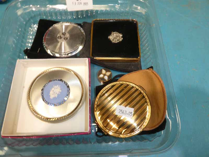 Five compacts and case by Kigu, Stratton etc