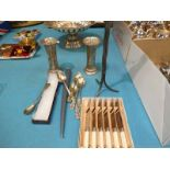 A pair of silver posy vases, silver teaspoon, candle stand, teaspoons and set of cake knives