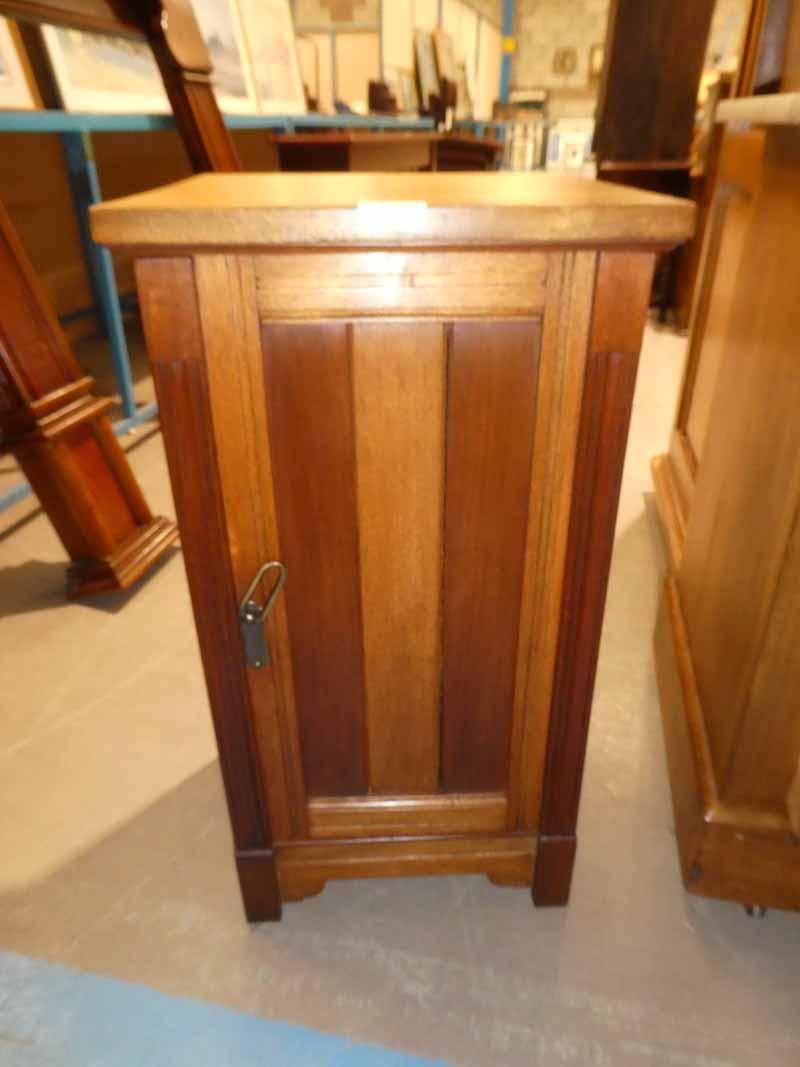 An Edwardian oak bedside pot cabinet