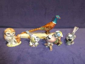 A Beswick pottery cock pheasant on plinth, old Mister Brown and four hedge birds