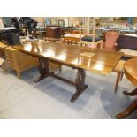 An oak refectory style dining table with a spare larger oak top