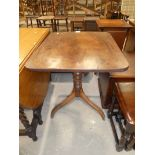 An early 19th century mahogany rectangular tilt top occassional table on triform support