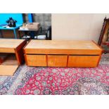 A pair of storage units as a king size bed base with drop down hinged doors