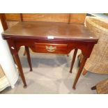 A Victorian style mahogany flip over and turn tea table with single frieze drawer , taper turned