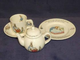 A wedgwood childrens breakfast service to include, cup, saucer, sideplate & teapot. Peter Rabbit