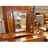 A freestanding toilet mirror and mahogany table lamp