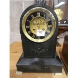 A black slate dome top French marble clock with brass and black face