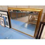 A large gilt framed wall mirror