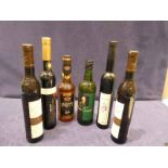 Four bottles of Rheinhessen eiswein, a bottle of sherry and a bottle of German rum