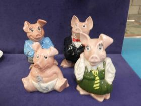 A set of four Wade Nat West pigs. Mother, father, girl & baby