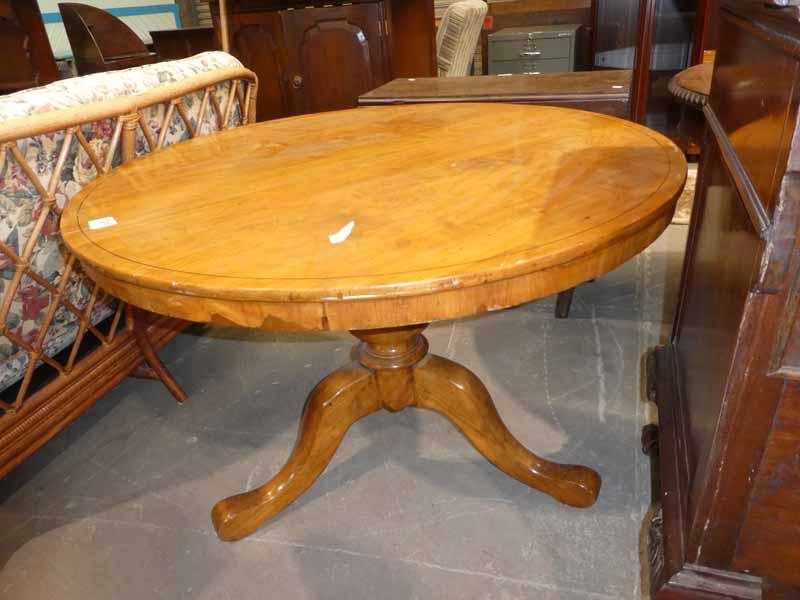 A Beech circular top extending Dining table on a triform support