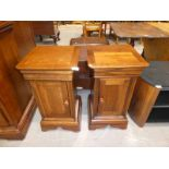 A pair of bedside pot cabinets to match lot 213