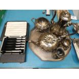 A Victorian silver plated melon shaped tea set, tray and broken creamer, plus three cased sets of