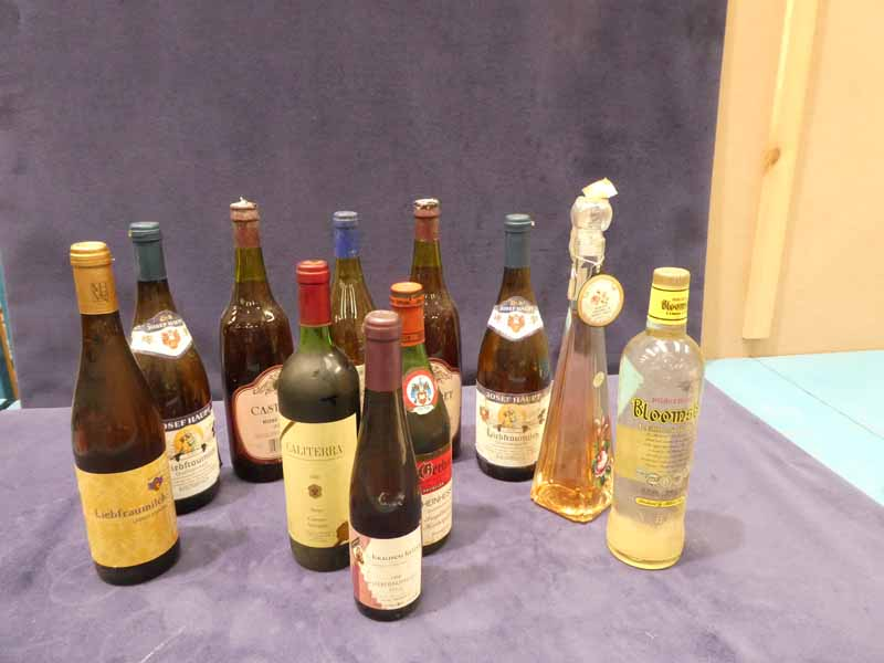 Eight bottles, one half bottle of mixed table wines and two bottles of lemon & gin and rose liquor