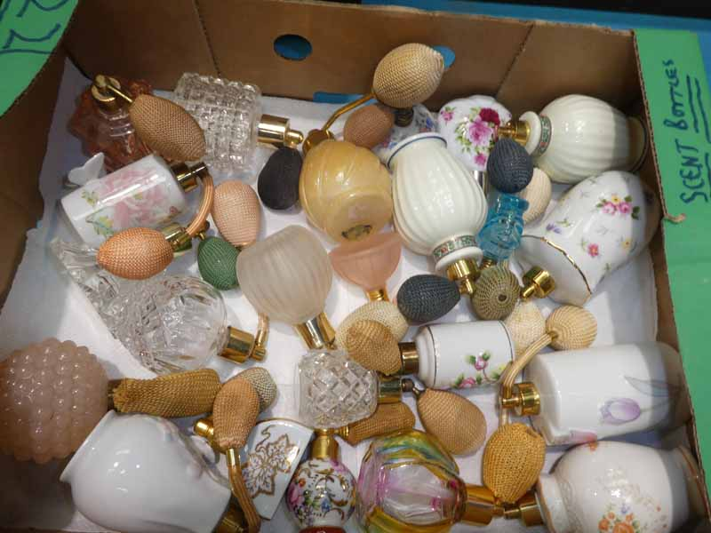 A collection of twenty two mixed perfume bottles and atomisers