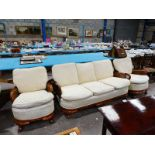 A mid century mahogany show frame Bergére Three Piece Suite with three seater Settee and a pair of