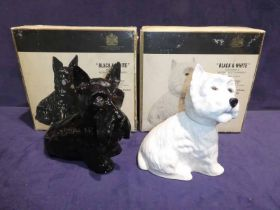 Two Buchanans, black & white Whisky decanters as seated Scottish & West Highland terriers - both