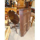 A Georgian mahogany circular tilt top table on triform support and a Georgian mahogany flat