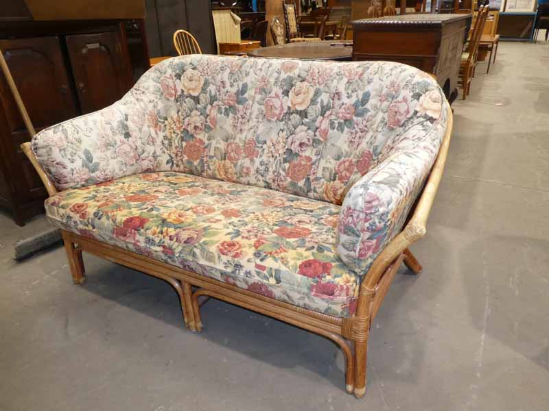 A cane conservatory settee