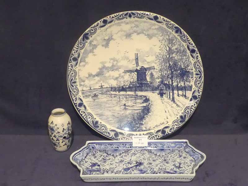 A 20th Century Dutch delft charger, small vase and rectangular tray