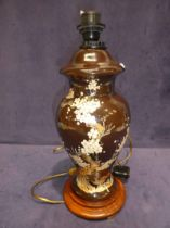 A decorative vase shape lamp base decorated with prunus blossom